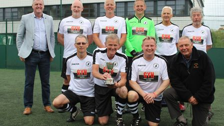 The Beccles Town team are pictured with Suffolk FA Chairman Phil Lawler (far left) who presented the