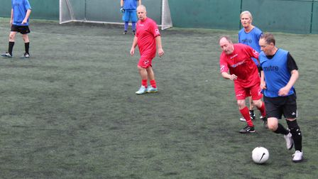 Action from the Walking Football Cup at Goals in Ipswich between Keep Activ Ipswich (blue shirts) an