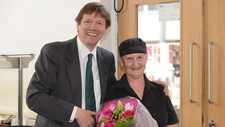 ramlingham College catering assistant Janice Moore, pictured with headmaster Paul Taylor, has been h