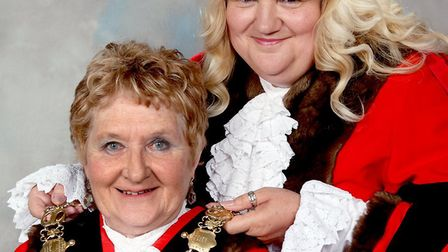 Outgoing Sudbury mayor Sarah Page hands over the official mayoral chain to Sue Ayres (front) Picture
