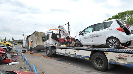 Damaged vehicles are recoverd from the scene. Picture: SARAH LUCY BROWN
