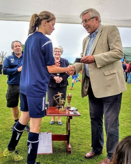 Aimee Collins receives a medal from Cllr Gordon Jones Picture: DANIEL COLLINS