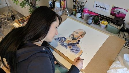 Louise Cobbold adding the finishing touches to her painting of Wolves head coach Nuno. Picture: CHRI