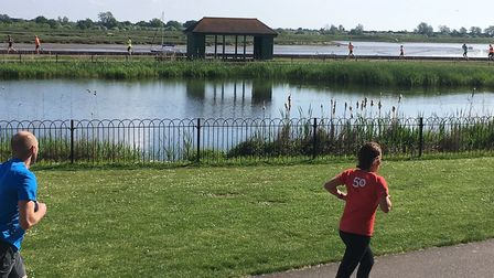 Runners in the foreground and background make their way around the two-lap course at the Maldon Prom