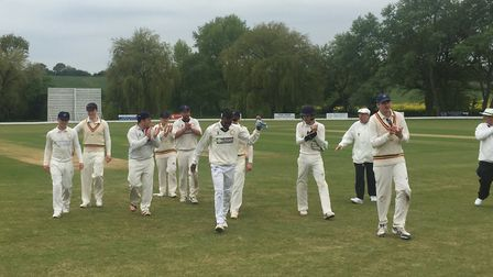 Brendon Louw walks off the pitch at Frinton with his Wivenhoe team-mates after taking a remarkable n