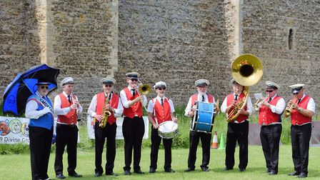 The Smokehouse Blue Marching Band performing beside Framlingham Castle Picture: SARAH LUCY BROWN