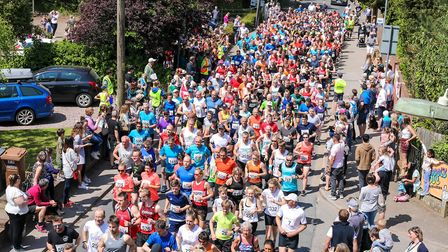 Runners stream through at the start of the Woodbridge 10k, on 20 May 2018. Picture: Steve Waller