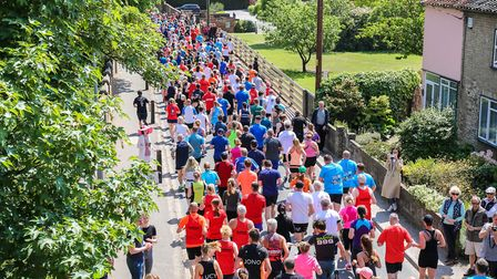 A rear view of the runners as they stream through at the start of the Woodbridge 10k, on 20 May 2018