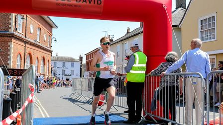 Andrew Rooke, winner of the Woodbridge 10k, crosses the finish in a time of 31 minutes 54 seconds.