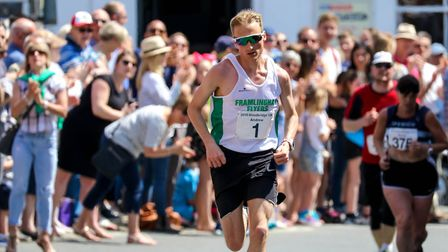 Andrew Rooke, winner of the Woodbridge 10k, races up onto the Market Hill, as he heads for the finis