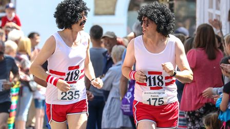 Brothers Andrew and Patrick Cooney, who raced in fancy dress, are pictured just after finishing the