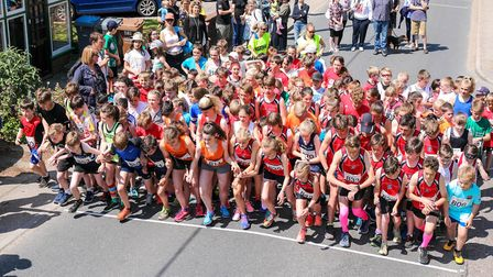 Ready for the off: The junior race runners leave the start. Woodbridge 10k, on 20 May 2018. Pictu