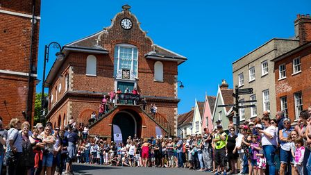 A large crowd on the Market Hill wait for the runners in the Woodbridge 10k to arrive. Picture: S