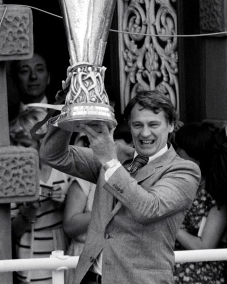 Robson holds the UEFA Cup aloft in 1981. Picture: PA