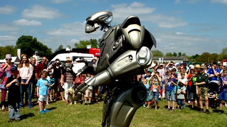 Crowds enjoy a hot and sunny day at the 179th Hadleigh Show on Saturday. Titan the Robot entertains