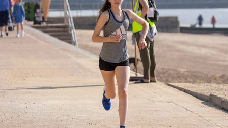 Milly Presland, on her way to finishing first female at the Clacton Seafront parkrun. Picture: PETE