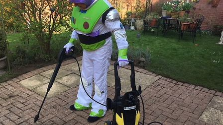 To infinity and beyond, Buzz Lightyear cleans the patio. Picture: LJM