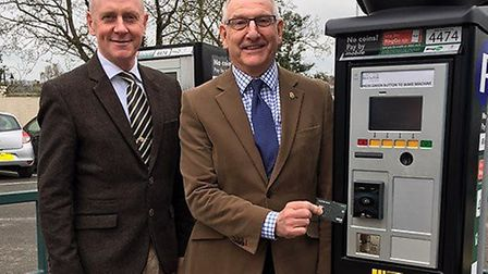Councillors Lance Stanbury and David Bowman demonstrate the pay by card machines that have been inst