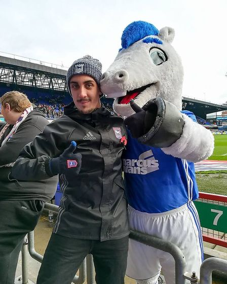 Spanish Ipswich Town 'super fan' Jose Lopez Lerena, with Bluey the mascot. Picture: MIKE BACON
