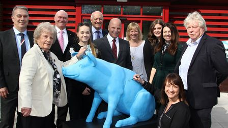 Pictured with the Big Blue Piggy are Julie Fayers (signing the pig) and Liz Fayers (giving her donat