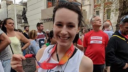 Jess Warren, with her finisher's medal. The Bury St Edmunds-based vet was raising money for the Anim
