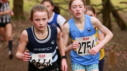 Ruby Vinton (left) on her way to victory at the South of England Cross Country Championships from ea
