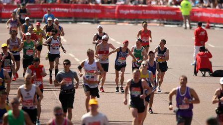 A runner is helped to the finish-line during the final few yards of the London Marathon. Picture: PA