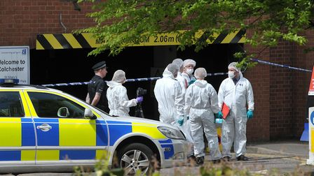 Forensics investigate the scene at St Mary's car park in Colchester. Picture: SARAH LUCY BROWN