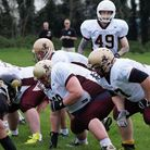 Ipswich Cardinals quarterback Matt Agate lines up to take the snap in their win against Essex Sparta