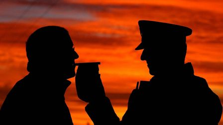 A police officer carrying out a breathalyser test. Picture: JOHN GILES/PA