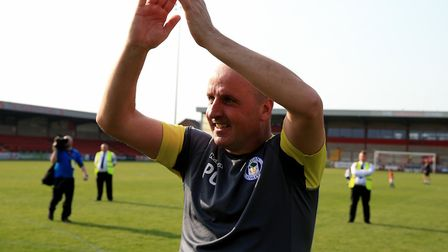 Wigan Athletic's manager Paul Cook celebrates his side's promotion to Championship at the weekend. H