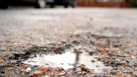 Suffolk County Council has said it is continuing its war on potholes. Picture: GREGG BROWN