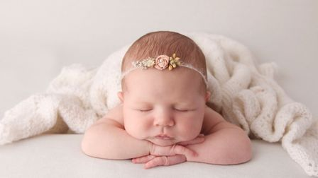 Baby Ruby, relaxing. An image by Baby Art UK