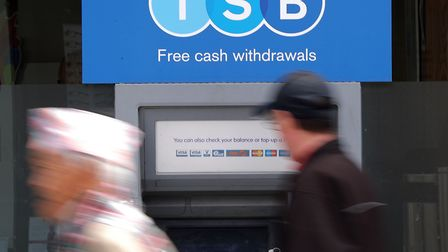 A man uses a TSB cash machine in Ashford, Kent, as the bank's boss has apologised for IT issues whic