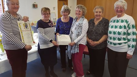 Carol Bull (far left) presenting the scroll to volunteers at Hopton Day Care Centre. Picture: CONTRI