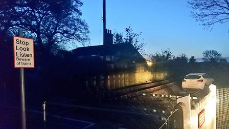 Police were called to reports that a vehicle had been driven through a fence onto the live railway l