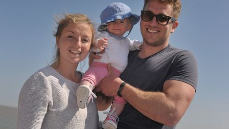 Cari, Ottilie and Simon Poacher enjoy the sunshine in Aldeburgh. Picture: SARAH LUCY BROWN