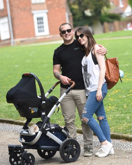 The Canham family enjoy the sunshine in Christchurch Park, Ipswich. Picture: GREGG BROWN