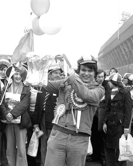 A Town fan with a foil FA Cup - his heroes would lift the real thing at Wembley. Picture: OWEN HINES