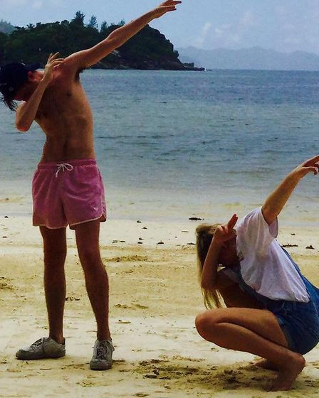 The picture which sparked a campaign. Tommy 'dabbing' with sister Molly on holiday. Picture: SUPPLIE