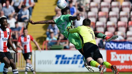 Junior Ogedi-Uzokwe lunges acrobatically for a cross but is beaten to it fractionally by Exeter City