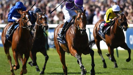 Saxon Warrior ridden by Donnacha O'Brien wins the Qipco 2000 Guineas Stakes during day one of the QI