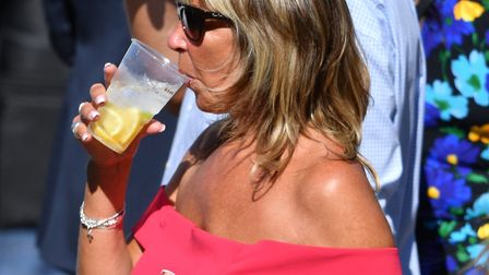 Racegoers enjoy drinks during day one of the QIPCO Guineas Festival at Newmarket Racecourse. Picture