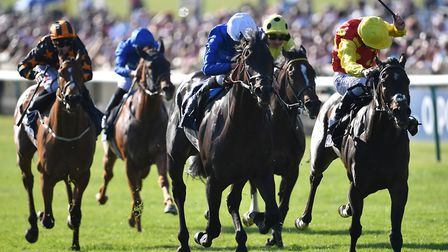 Symbolization ridden by William Buick (centre) wins the Qipco Racing Welfare Handicap during day one