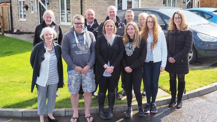 The Farrant family meet councillors from Babergh District Council outside their new home in Hammond