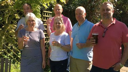 The Low House Laxfield CIC celebrate buying the pub, pictured l-r, Alison Oughton, Tim Woolnough, Em