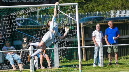 Woodbridge 'keeper Alfie Stronge makes a flying save at Whitton. Photo; PAUL LEECH