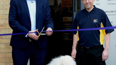 Guy Butterworth, Brett Carpenter, store manager, and the Dulux dog officially open Dulux Decorator C