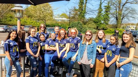 EADT reporter Katy Sandalls with girls football players from Capel Plough. Picture: DANIEL COLLINS