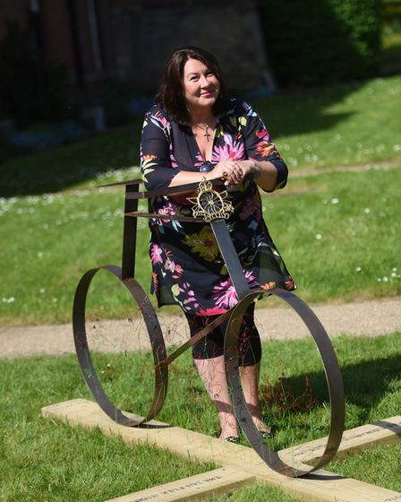 Artist Trudi Edmunds with her bicycle sculpture in memory of her great great uncle who died in the F